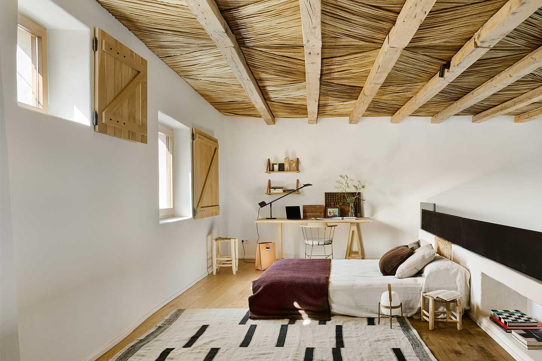 camera da letto stile rustico e nordico